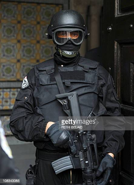 A bodyguard of Tunisian Interior Minister Ahmed Friaa stands guard during the first ministers' session of Tunisia's newly appointed transitional...