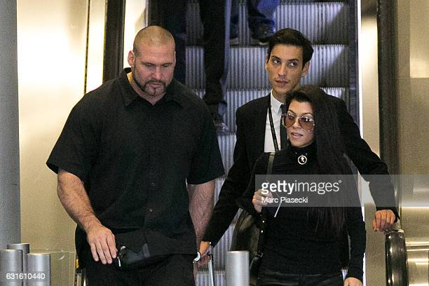 Bodyguard Pascal Duvier Gary Madar and Kourtney Kardashian are seen at CharlesdeGaulle airport on September 29 2016 in Paris France