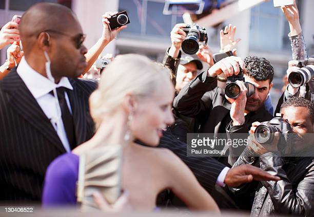 Bodyguard protecting celebrity from paparazzi