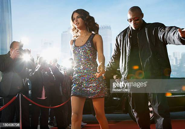 bodyguard protecting celebrity on red carpet - actor stock pictures, royalty-free photos & images