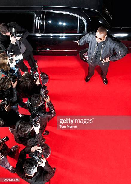 Bodyguard protecting limo from paparazzi