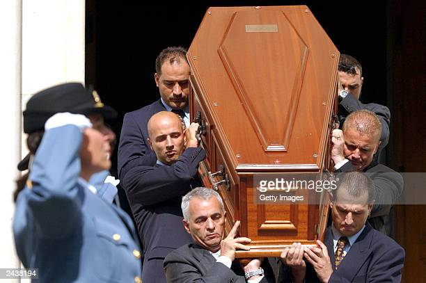 Bodyguards carry the coffin of UN Special Envoy to Iraq Sergio Vieira de Mello in front of UN security staff after the funeral ceremony at Saint...