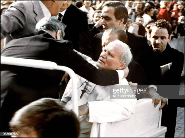 Bodyguards hold Pope John Paul II after he was shot 13 May 1981 on Saint Peter's square by a Turkish extremist Mehmet Ali Agca Agca was jailed for 19...
