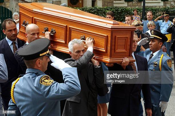 Bodyguards of UN special envoy Sergio Vieira de Mello carry his coffin in front of UN security staff after the funeral ceremony at Saint Paul's...