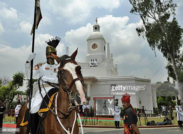 Bodyguards stand at the site where Indian President Pranab Mukherjee inaugurats restored clock tower at the President's Estate on the eve of...