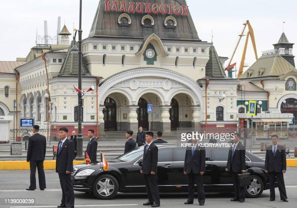 Bodyguards surround a limousine from North Korean leader Kim Jong Un's motorcade outside the railway station in the fareastern Russian port of...