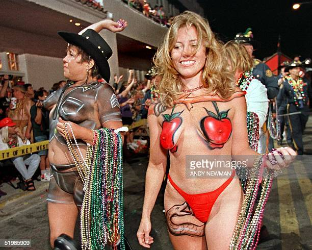 Bodypainted revelers march down Duval Street in Key West Florida late 27 October 2001 during the Fantasy Fest Parade a highlight event of the annual...