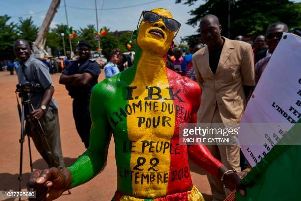 A bodypainted supporter of Ibrahim Boubacar Keita poses during celebrations marking Mali's 58th anniversary of independence in Bamako on September 22...