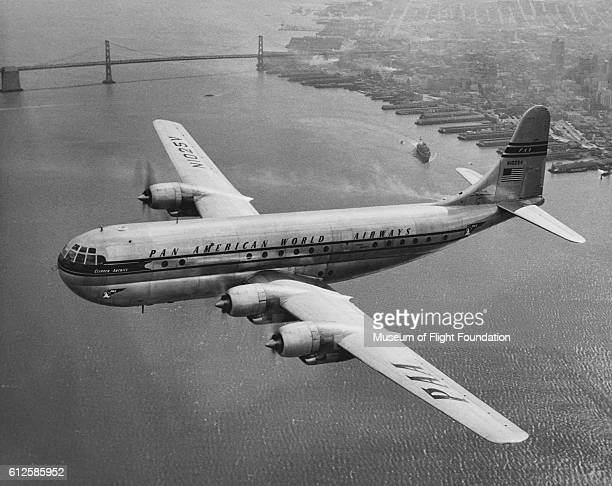A Boeing 377 Stratocruiser being used by Pan American Airways for passenger transport over San Francisco in the mid20th century | Location over San...