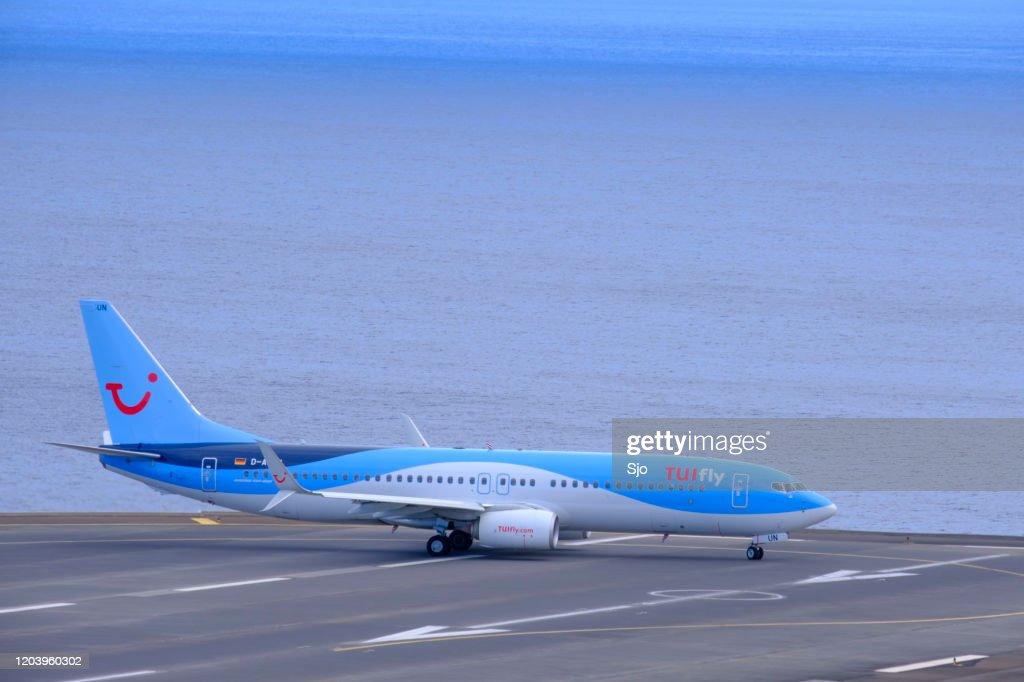 TUI Boeing 737 Airplane preparing to take off from Airport Cristiano Ronaldo on Madeira  island, Portugal : Stock Photo