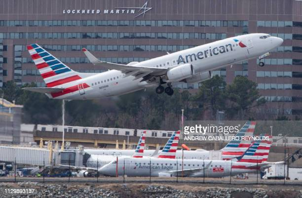A Boeing 737 flown by American Airlines passes by the Lockheed Martin building as it takes off from Ronald Reagan Washington National Airport in...