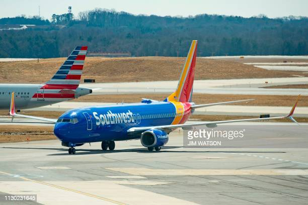 A Boeing 737 flown by Southwest Airlines taxis to the gate at Baltimore Washington International Airport near Baltimore Maryland on March 13 2019 US...