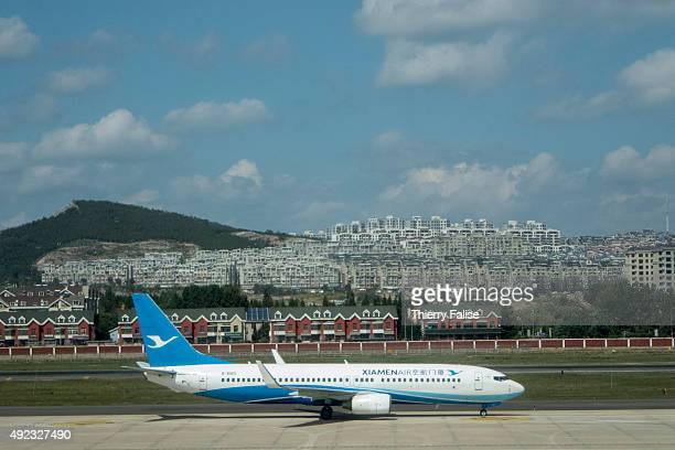 Boeing 737 from Xiamen Air is parking at Dalian airport