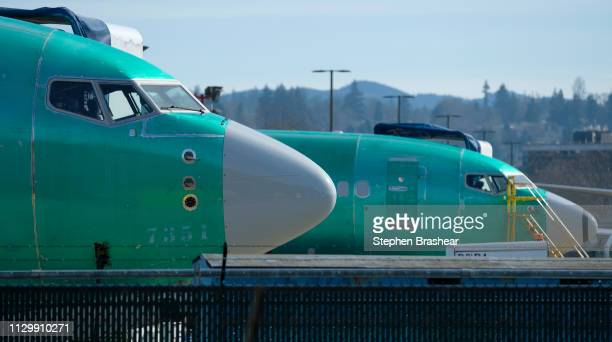 Boeing 737 MAX 8 airplane sits next to another 737 outside the company's factory on March 11 2019 in Renton Washington Boeing's stock dropped today...