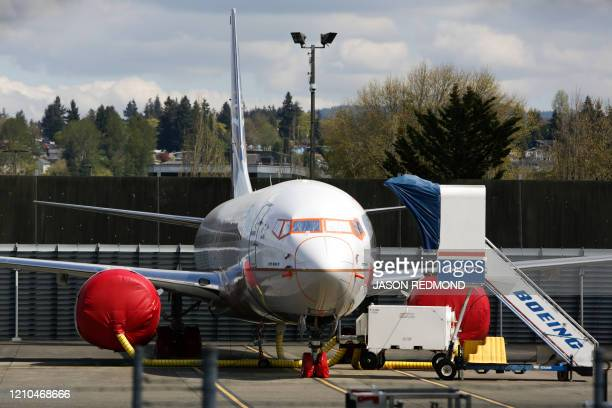 A Boeing 737 MAX 9 airliner is pictured on the flight line at the Boeing Renton Factory in Renton Washginton on April 20 2020 Boeing announced it...