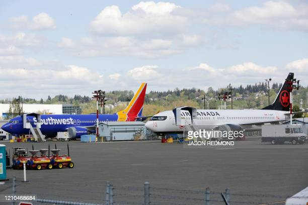 Boeing 737 MAX 9 airliners are pictured on the flight line at the Boeing Renton Factory in Renton Washginton on April 20 2020 Boeing announced it...