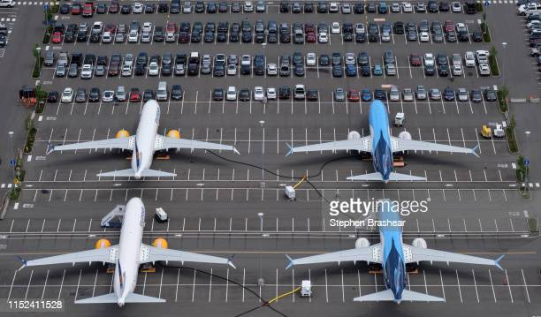 Boeing 737 MAX airplanes are stored on employee parking lots near Boeing Field, on June 27, 2019 in Seattle, Washington. After a pair of crashes, the...