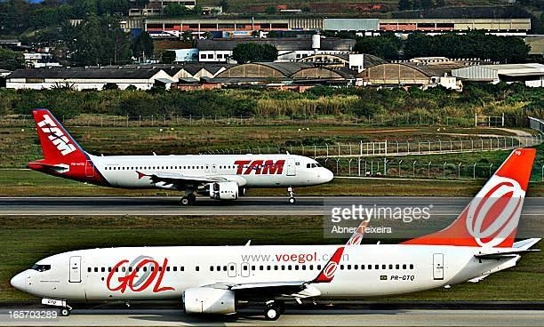 CONTENT] GOL Boeing 737 Next Gen MSN 36146 and TAM Airbus A320 MSN Aeroporto Internacional de Guarulhos São Paulo Brazil Airport Brazil GRU airplane...