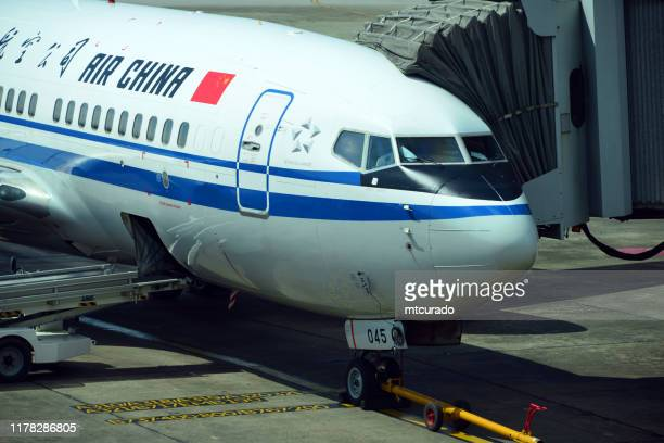 boeing 737 ng (air china) at a jet bridge in yangon international airport, myanmar - new generation stock pictures, royalty-free photos & images