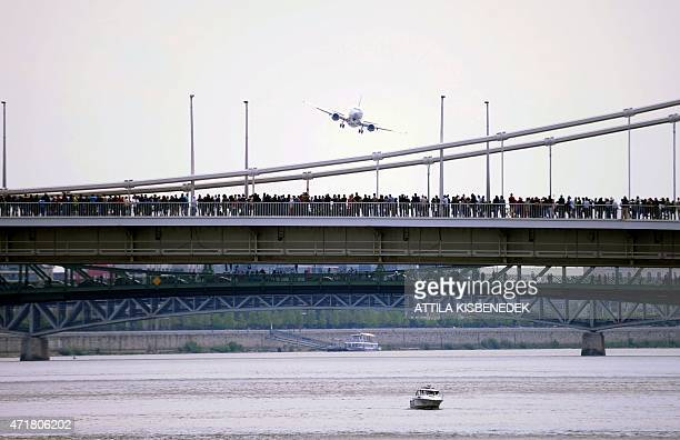 A Boeing 737400 airplane flies over the Elisabet Bridge on May 1 2015 during a flying and car show around the Danube River of Budapest downtown AFP...
