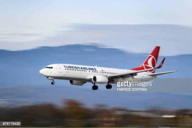 Boeing 737-800 commercial plane registration TC-JVL of Turkish Airlines is seen landing at Geneva Airport on November 20, 2017 in Geneva. / AFP PHOTO...