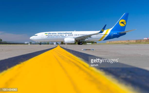 boeing 737-800 of ukraine international airlines  is preparing to take off at the airport boryspil, ukraine. - boeing 737 800 stock pictures, royalty-free photos & images