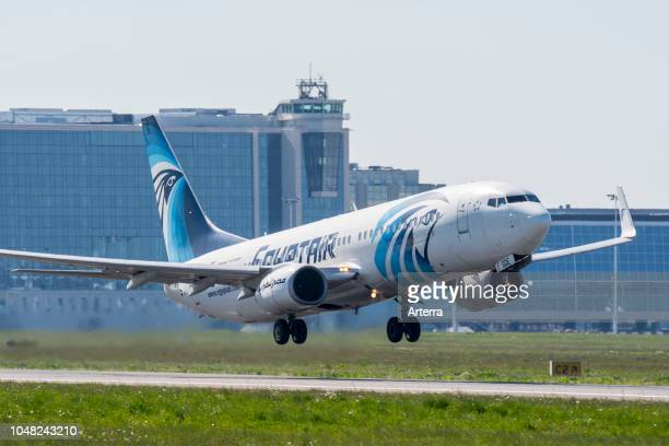 Boeing 737-800, two engine short- to medium-range, narrow-body jet airliner from EgyptAir, Egyptian airline taking off from runway.