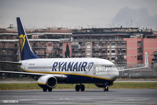 A Boeing 7378AS bearing the Ryanair Irish lowcost airline livery taxies on the runway of Rome's Ciampino airport on January 14 2019