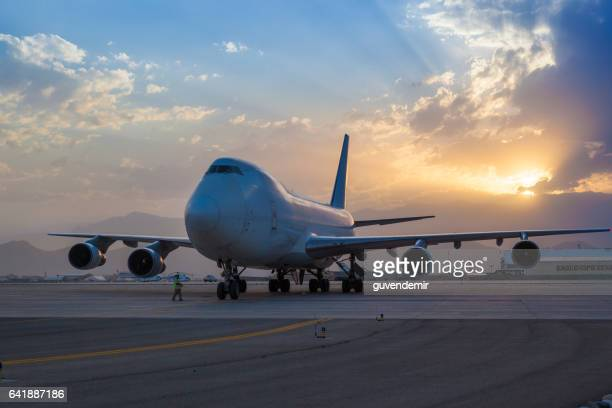 boeing 747 cargo airplane at sunset - cargo airplane stock photos and pictures