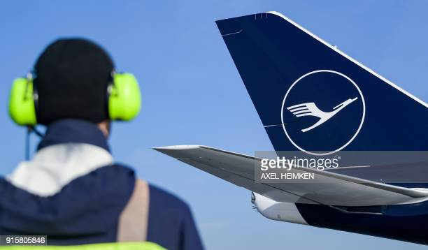 A Boeing 7478 displaying the new logo of the German airline Lufthansa parks at Helmut Schmidt Airport in Hamburg northern Germany on February 8 2018...