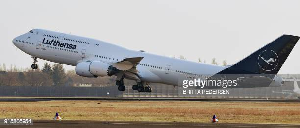 A Boeing 7478 displaying the new logo of the German airline Lufthansa takes off at the Airport Tegel in Berlin on February 8 2018 / AFP PHOTO / dpa /...