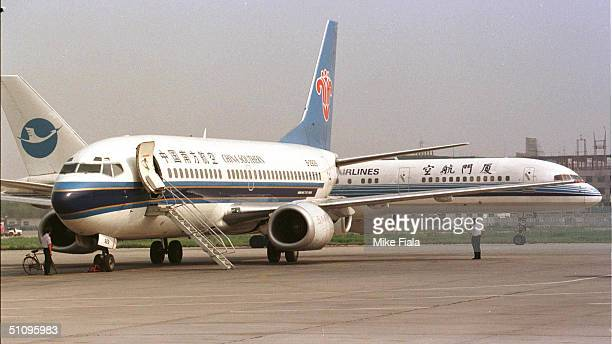 A Boeing 757 Passes A Boeing 737 At The Beijing International Airport Tuesday June 25 1996 President Of Boeing Phil Condit Said That Political...