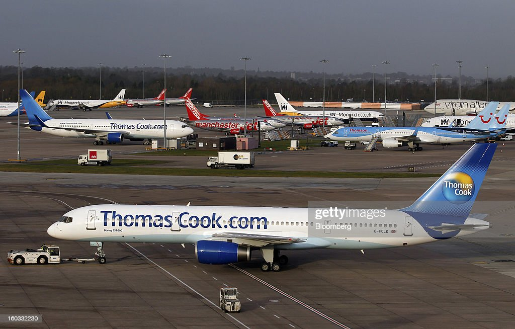 A Boeing 757-200 aircraft, operated by Thomas Cook Group Plc, is maneuverd into position near terminal one of Manchester airport in Manchester, U.K., on Tuesday, Jan. 29, 2013. Manchester Airports Group, owner of Britain's busiest airport outside London, is buying Stansted from Heathrow Airport Ltd., which is ceding 100 percent of Stansted to comply with regulatory requirements. Photographer: Paul Thomas/Bloomberg via Getty Images