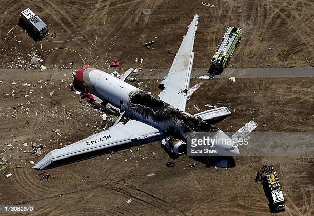 Boeing 777 airplane lies burned on the runway after it crash landed at San Francisco International Airport July 6, 2013 in San Francisco, California....