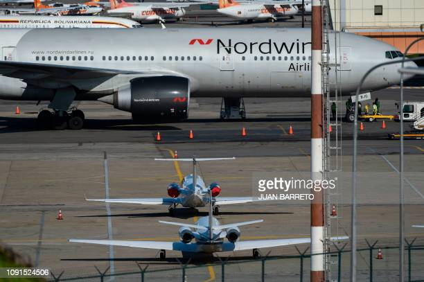 A Boeing 777 from Russia's Nordwind Airlines remains parked on the runway at La Guaira airport 30 km from Caracas on January 30 2019