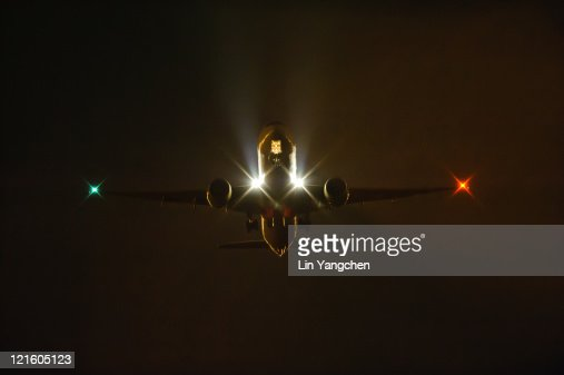 Boeing 777 Night Takeoff Stock Photo