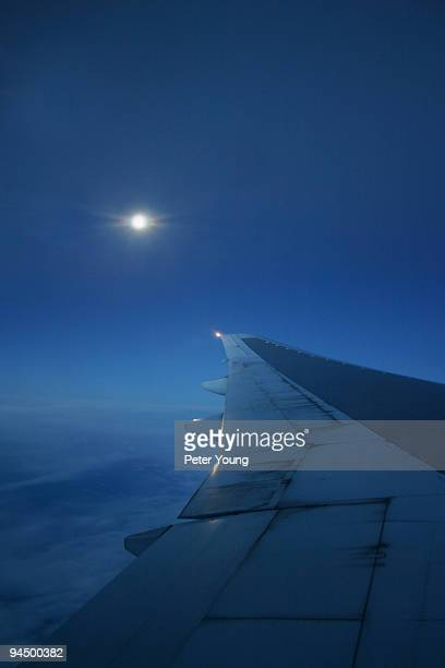 Boeing 777 wing with moon