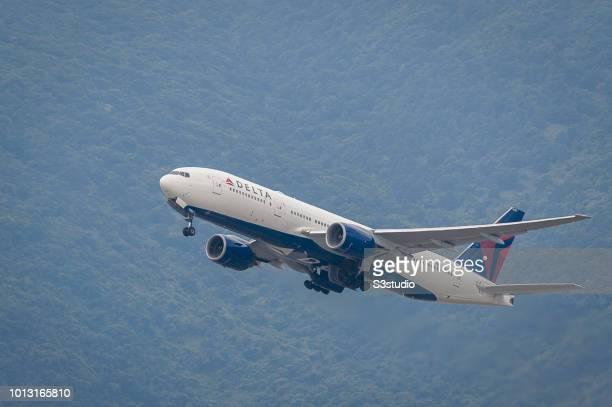 Boeing 777-232 passenger plane belonging to the Delta Air Lines taking off at Hong Kong International Airport on August 08 2018 in Hong Kong, Hong...
