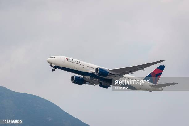 Boeing 777-232 passenger plane belonging to the Delta Air Lines taking off at Hong Kong International Airport on August 08 2018 in Hong Kong, Hong...