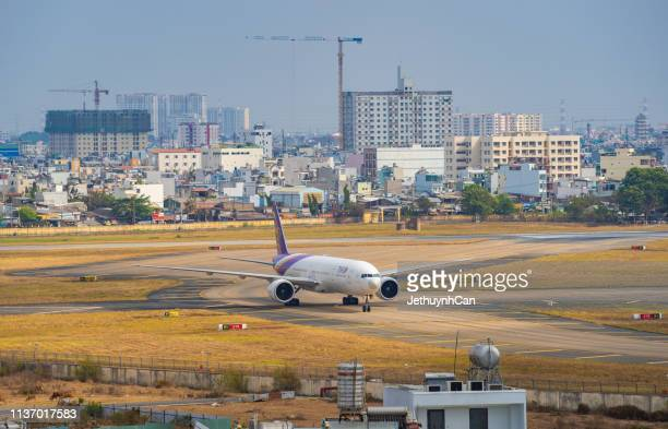 Boeing 777-300ER airplane of Thai Airway taxiing on runway of Tan Son Nhat Airport (SGN) in Saigon