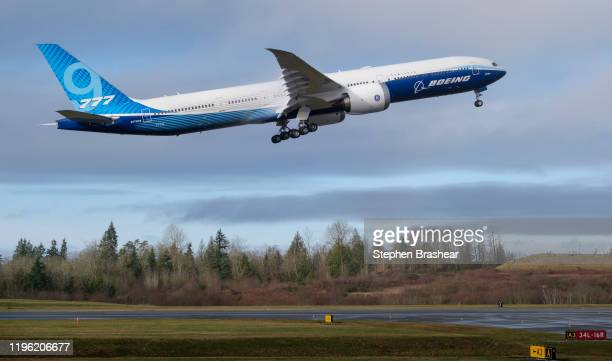 Boeing 777X airliner lifts off for its first flight at Paine Field on January 25 2020 in Everett Washington The plane is the latest iteration of its...