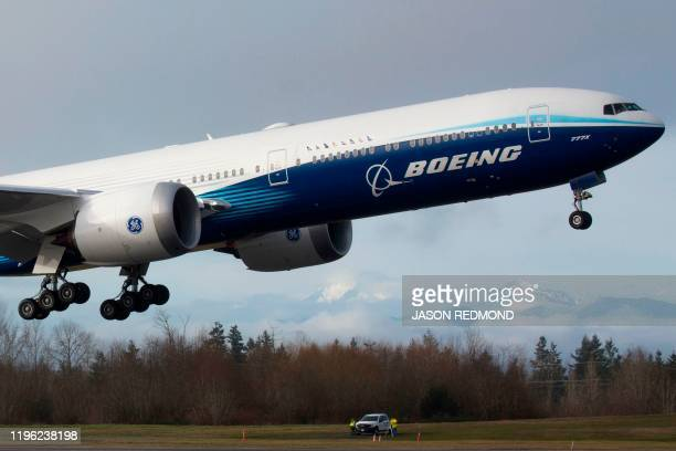 Boeing 777X airplane takes off on its inaugural flight at Paine Field in Everett, Washington on January 25, 2020. - Boeing's new long-haul 777X...