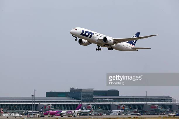 A Boeing 7878 Dreamliner aircraft operated by LOT Polish Airlines SA takes off at Warsaw Chopin airport in Warsaw Poland on Saturday Aug 29 2015...
