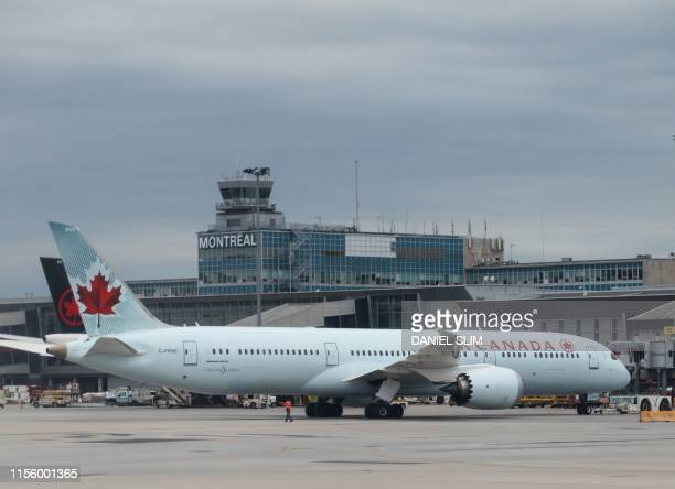 A Boeing 7879 Dreamliner of Air Canada sits at gate at MontréalPierre Elliott Trudeau International Airport on July 16 2019