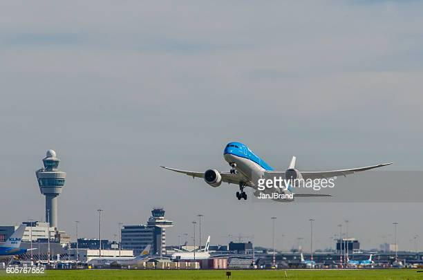 boeing 787-9 dreamliner of klm taking off at schiphol. - schiphol airport stock photos and pictures