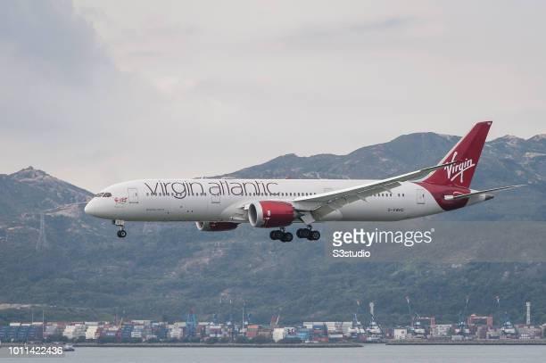 "Boeing 787-9 passenger plane belonging to the Virgin Atlantic lands at Hong Kong International Airport on August 01 2018 in Hong Kong, Hong Kong. ""n"