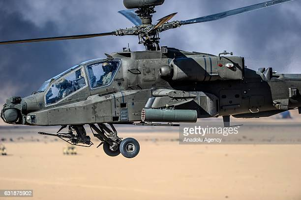 Boeing AH64 Apache helicopter flies during the Exercise Storm of 2017 in Jahra Kuwait on January 17 2017 Fighter jets and helicopters of Kuwait Air...