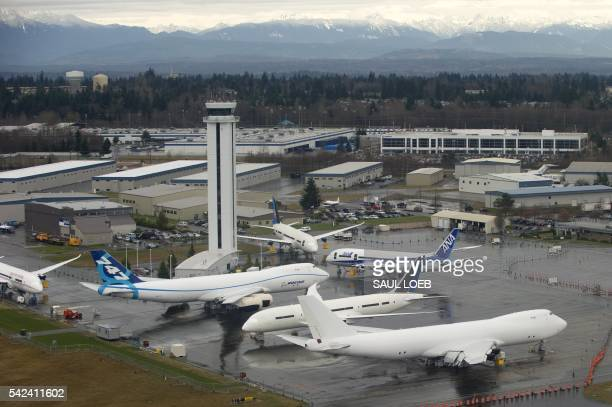 Boeing airplanes including the Boeing 747 and the Boeing 787 Dreamliner aircraft sit on the tarmac at the Boeing production facilities at Paine Field...