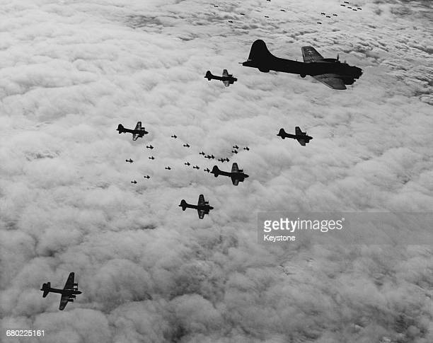 Boeing B17G Flying Fortress fourengine heavy bombers of the United States Army Air Forces 8th Air Force in flight combat box formation on a bombing...