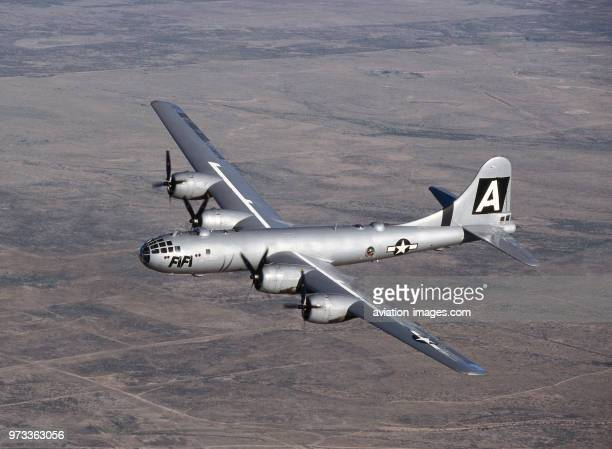 Boeing B-29 Super Fortress named 'FiFi' flying over a desert landscape at the 1997 Confederate-Air-Force Airshow.